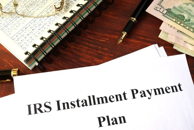 Tax Payment Installments | How Do Tax Resolution Services Work When Owing Back Taxes