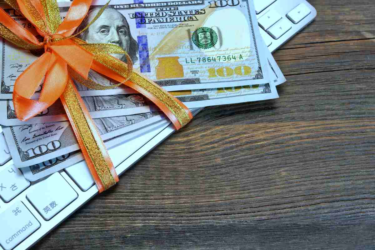 money tied ribbon on computer keyboard | IRS Rules On Gifts | gift tax