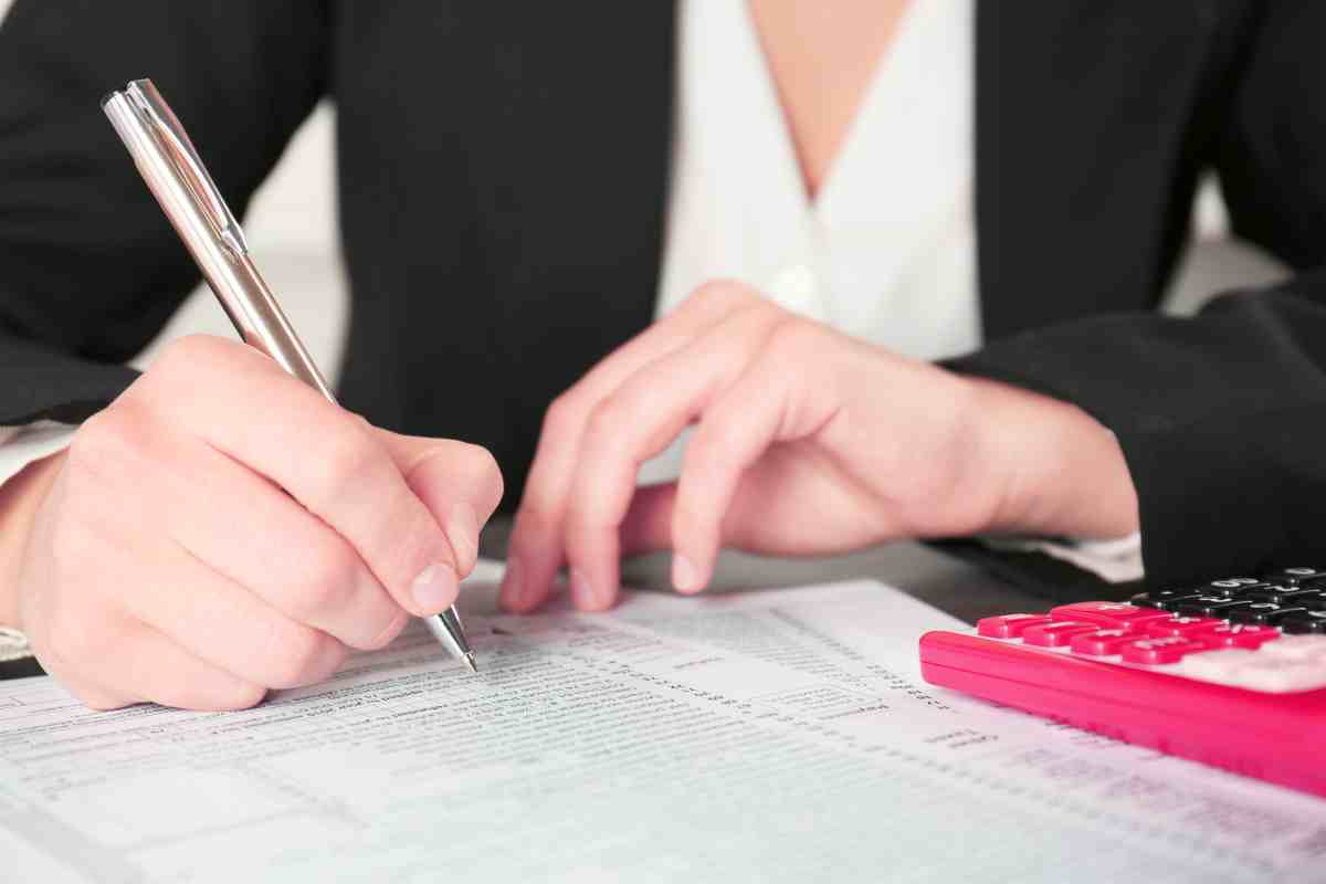 businesswoman filling individual income tax return   IRS Installment Agreement Types   How Can It Help You   Installment plan