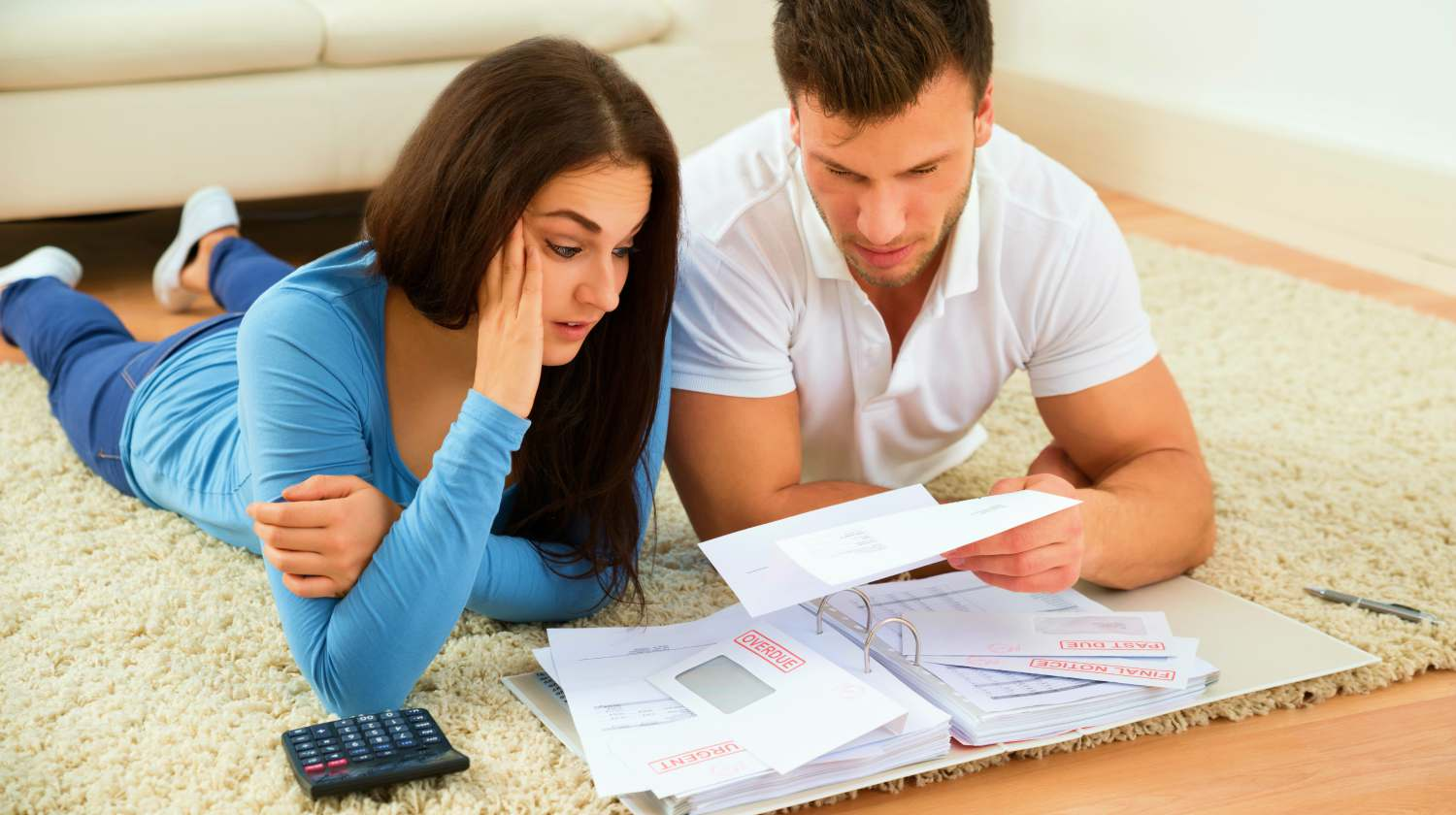 Feature | couple worried about bills | Tax Relief Tips You Can Do When You're In Tax Trouble | Tax trouble