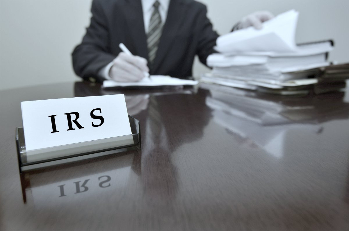 IRS tax auditor reviewing documents   Qualifications For The IRS Fresh Start Program   fresh start program   fresh start program irs