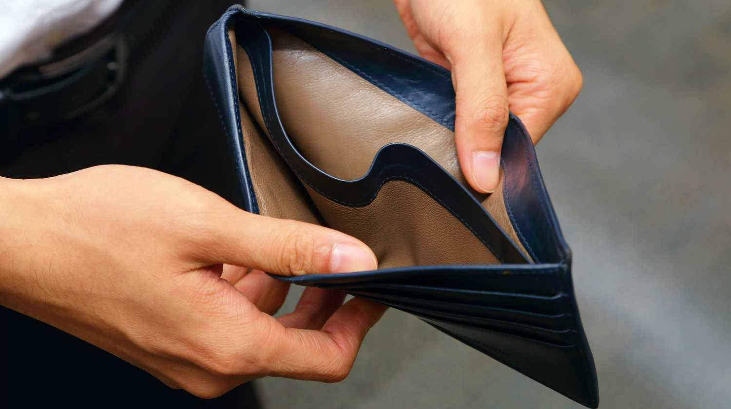Feature | person showing empty wallet | How To Prove Financial Hardship To The IRS | irs hardship forms
