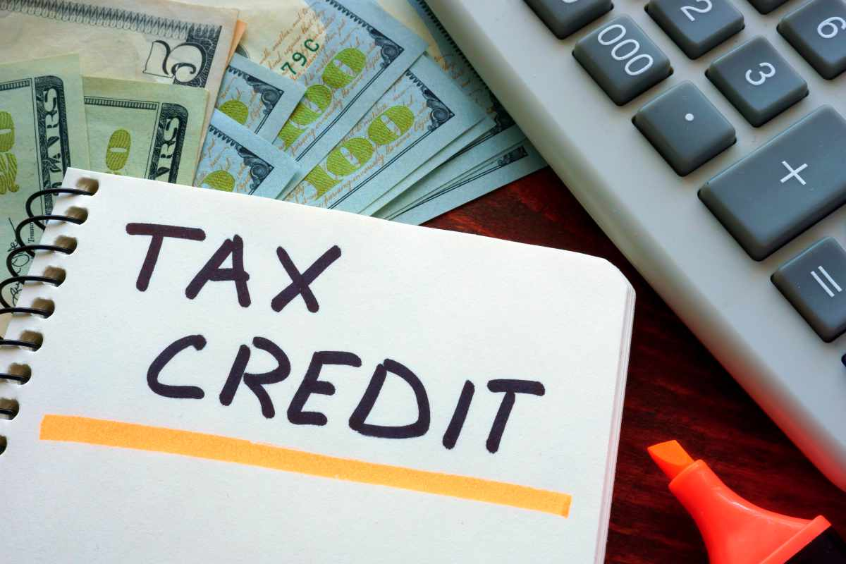 tax credit on notebook | Reasons To Speak To A Tax Relief Specialist About Your Back Taxes ASAP | tax relief companies