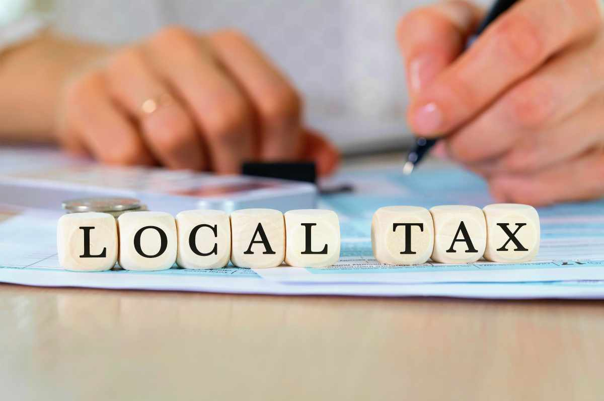local tax word on blocks   Reasons To Speak To A Tax Relief Specialist About Your Back Taxes ASAP   tax debt relief