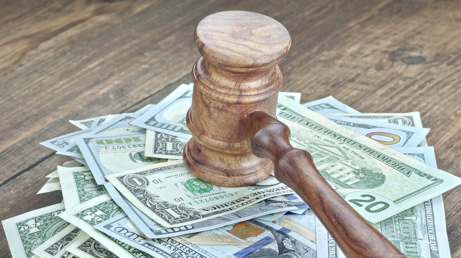 Feature | money and gavel | IRS Penalties: Tax Evasion, Tax Fraud, And Other Tax Crimes | irs penalties