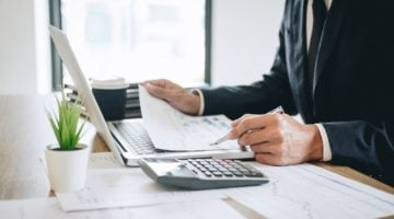 Featured | businessman working | What Are Deferred Tax Liabilities? | deferred tax liability